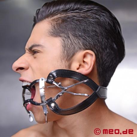 Divaricatore orale con protezione per i denti e cinturino per la testa
