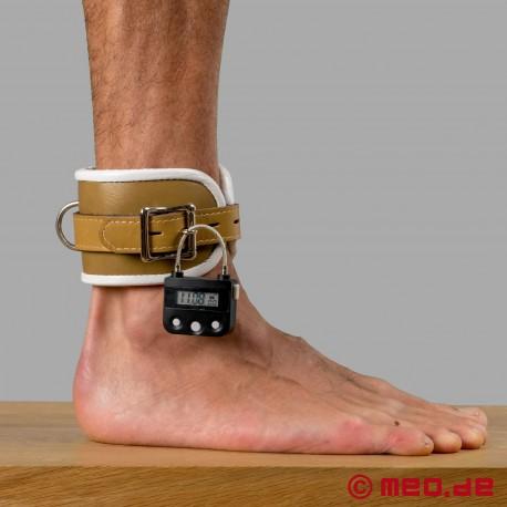 Manette per caviglie richiudibili con lucchetto a tempo - tema psichiatria