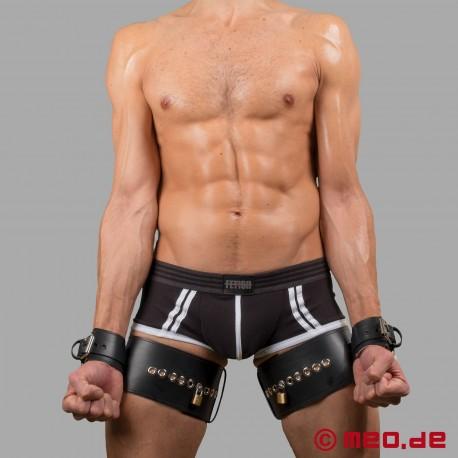 Thigh restraint with wrist cuff (wrist to thigh restraint)