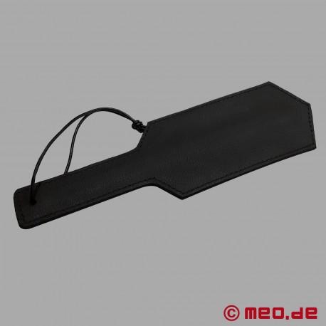 Paddle BDSM in pelle con rivetti